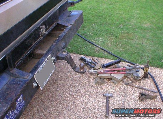 """bumper-junk.jpg This is what I usually store in the rear bumper: shackle draw bar 4"""" drop draw bar with 2"""" ball bottle jack bolt cutters various draw bars hammer tire chocks cribbing fluid transfer pump 10,000# snatch block screw-in tree cleats tree saver strap 20' chain 10'chain 3' chain axe machete come-along trailer connector adapters various bars & bolts whatever else I can stuff in there...  [url=http://www.supermotors.net/registry/media/292107][img]http://www.supermotors.net/getfile/292107/thumbnail/rear-seethru-s.jpg[/img][/url] . [url=http://www.supermotors.net/vehicles/registry/media/65184][img]http://www.supermotors.net/getfile/65184/thumbnail/chassis_tank_l.jpg[/img][/url]  That latch never worked right, so eventually, it went away.  This bumper ended up weighing ~180# empty (when it was on the '83 frame).  [url=http://www.supermotors.net/registry/media/932169][img]http://www.supermotors.net/getfile/932169/thumbnail/rearofh.jpg[/img][/url]  See the NEXT pic..."""