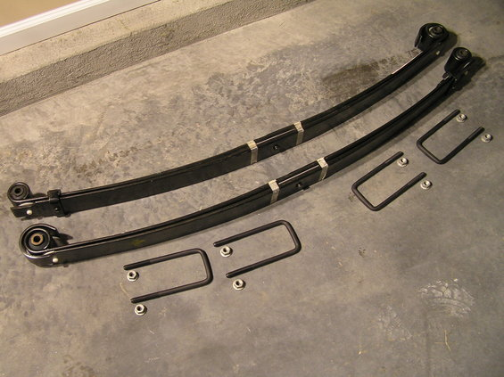 """p1200001.jpg [b]Ford SuperDuty V-Code Leaf Spring Installation on a 2000 Ford Excursion[/b]  [b]The Problem[/b] It's widely known that Excursions, while sharing a similar chassis to the F-250, do not share the same leaf springs from the factory. Due to the SUV body style of the Excursion, leaf springs specific to the Excursion come from the factory so the Excursion will fit in your standard garage and parking garage. The result: front leaf springs with significantly reduced travel (on 4x4 models) that eventually sag and leave less than 1"""" of leaf spring travel...further resulting in a very harsh ride.  [b]Why V-Code Springs instead of standard Excursion springs?[/b] After 175,000 miles, I had about 5/8"""" of clearance between the leaf spring and the bump-stop. I could feel every bump I'd drive over on the road. It was time to swap springs. Instead of swapping back to factory Excursion springs, I opted for """"V-Code springs"""" which ended up providing me with 1.5"""" of additional frontend lift over my sagging factory springs.  [b]Parts Needed[/b] (8 ) Nuts - Part # N805480-S426 (2) V-Code Leaf Springs - Part # 2C3Z-5310-HA (2) U-Bolts - unfortunately the u-bolts I ordered at the dealer were incorrect. My Excursion has a rounded-square u-bolt style, but I was given square-style u-bolts (Square-style u-bolt Part # is F81Z-5705-BA)  [b]Tools Needed[/b] We'll cover tools needed in each step.  [b]Estimated Time Required[/b] 6-8 hours  [b]Difficulty[/b] 7 out of 10 (1 being easiest, 10 being hardest)  [b]Questions/Comments?[/b] Discuss them in [url=http://www.supermotors.net/clubs/fordexcursions/forums/thid-6099]this forum thread[/url]."""