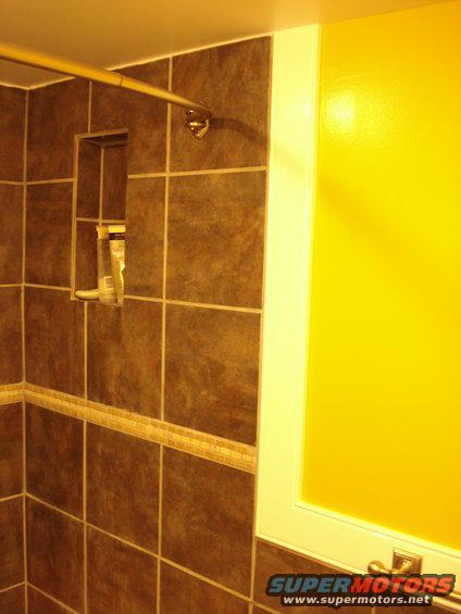 014.jpg not the best pic, but there is a recessed shelf built into the shower using the same tile as the shower itself