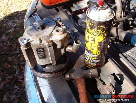 """02smogpump.jpg For a full explanation of emissions system, read [url=http://www.fourdoorbronco.com/board/showthread.php?5427-Emissions-Systems]this article[/url].  This is how to fix a seized air pump for nearly nothing: 1) break the three 10mm pulley bolts 2) remove the belt 3) remove the pulley bolts 4) loosen the two hose clamps (5/16"""", 8mm, flathead) and push the hoses back 5) remove the 9/16"""" (14mm) upper bolt 6) remove the 1/2"""" lower rear bolt 7) pry the pump case forward to open the clamp sleeve around the upper bolt hole, and remove the pump 8 ) reinstall the pulley bolts finger-tight 9) spray penetrating oil liberally into the hose nipples & the two 3/16"""" vent holes in the back of the case, rolling the pump to distribute the oil thoroughly; allow the oil to soak in for several minutes IF ANY METAL CHUNKS OR FILINGS FALL OUT, replace the smog pump 10) use a propane torch to warm the case just so it's hot to the touch; don't melt any plastic or set fire to the oil 11) holding the assembly by the pulley, strike the large boss running across the bottom of the pump back & forth (sideways) to break the impeller loose of the corrosion inside; apply more oil as necessary 12) continue rotating the pump at least a full turn with the hammer; when it's loose enough, spin it by hand until it turns smoothly 13) dump as much oil as possible out of the hose nipples 14) if you plan to ford deep water, plug the vent holes with silicone rubber or RightStuff  UPDATE:  After several months & a few tanks of gas, it's still working fine. UPDATE:  After a few years of intermittent use, being sandblasted & painted, it's still spinning smoothly. [url=https://www.supermotors.net/registry/media/1055021][img]https://www.supermotors.net/getfile/1055021/thumbnail/05gray47.jpg[/img][/url] . [url=https://www.supermotors.net/registry/media/1056802][img]https://www.supermotors.net/getfile/1056802/thumbnail/06bracket10.jpg[/img][/url]  See also: [url=https://www.supermotors.net/registry/media"""